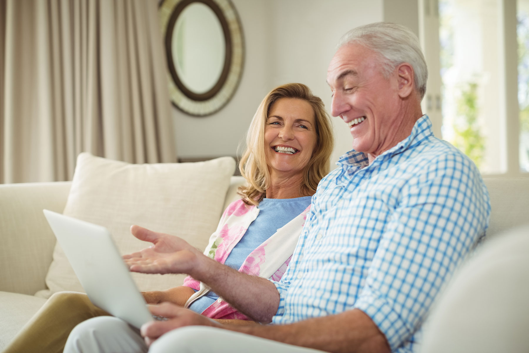 Senior Couple at home using m.Care remote patient monitoring technology