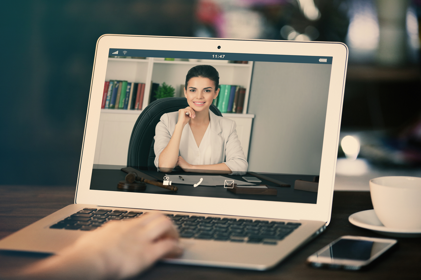 Woman video conferencing with m.Care technology